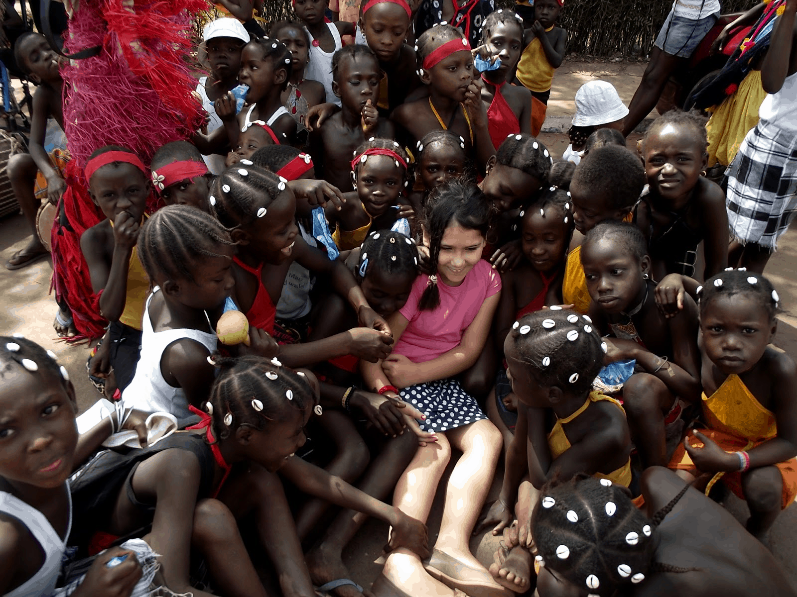 Francisca at a Carnival in Guinea Bissau with local school children.